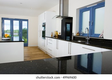 An brand new open plan kitchen and dining area in a large contemporary property
