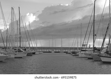 The brand new port of Rosignano in Tuscany, Italy. The harbor seen in the evening offers a unique atmosphere in the world, with its beautiful boats and yachts. Italy, 2017. Blur is a part of the image