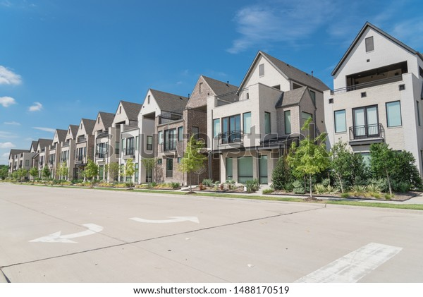 Brand new row of three story single family houses in Richardson, North Dallas location. Modern design of urban living residences with side private courtyards, sophisticated finishes, new development