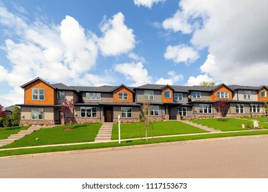 Brand new row of townhomes for sales in North American suburban neighborhood