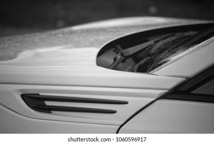 A brand new sports car in black and white