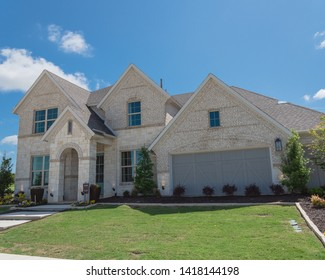 Brand new two story house with attached garage in new development neighborhood near Dallas, Texas, USA. Model house with American flag