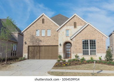 Brand new two story residential house, newly constructed and freshly built with landscaped yard. Real estate development in suburban neighborhood at Irving, Texas, USA
