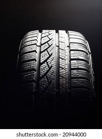 Brand new winter tire pattern on black background