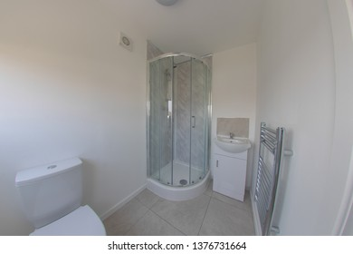 Brand newly refurbished bathroom showing a new shower, toilet and sink.