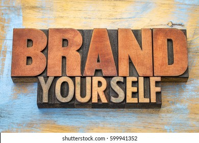 Brand yourself  - word abstract in vintage letterpress wood type blocks against grunge wooden background