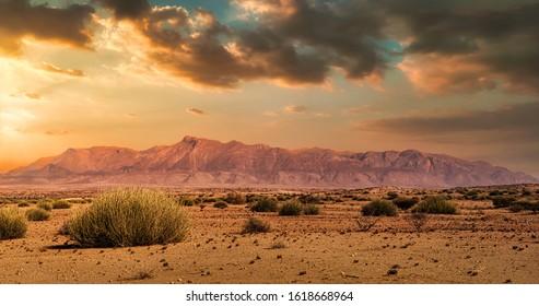 Brandberg mountain in namibia Damaraland. Sunset sunrise fire. Travel Destination Erongo near the coast highest point Königstein. Brandberg Massif or Intrusion. Holiday and vacation Africa tour.