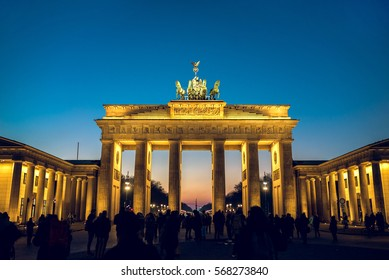 Brandenburg gate in Berlin, Germany during winter evening. Toned image.