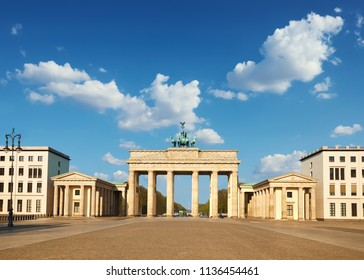 Brandenburg Gate in Berlin, Germany, on a bright day with blue sky. Front shot, space for your text