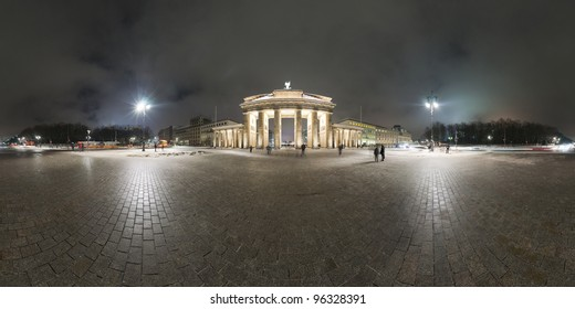 Brandenburg Gate in Berlin, Germany. Panorama is made late cloudy January evening. 360 degree panoramic composition.
