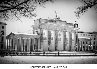 Brandenburg gate (Brandenburger Tor) and 18th of March Square in snow, Berlin, Germany, Europe, Black and white
