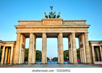 Brandenburg gate (Brandenburger Tor) in Berlin, Germany at sunrise