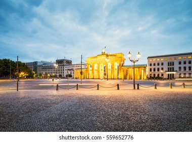 Brandenburg Gate (BrandenburgerTor) Berlin empty illuminated Panorama with Traffic and Clouds in Berlin, Germany, Europe