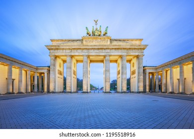 The Brandenburg Gate monument at night in Berlin city, Germany.