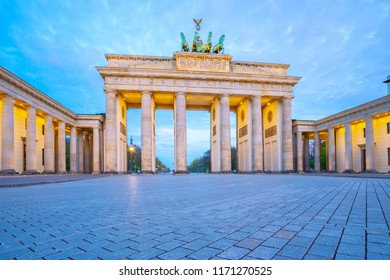 The Brandenburg Gate at twilight the famous place in Berlin, Germany.