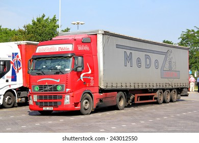 BRANDENBURG, GERMANY - JULY 20, 2014: Red semi-trailer truck Volvo FH12.460 at the parking near the interurban freeway.