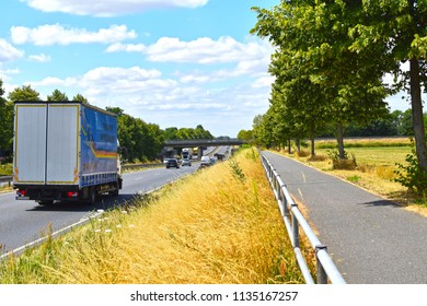 Brandenburg, Germany - July 9, 2018: Federal highway with different vehicles and a bike path on the edge of Berlin