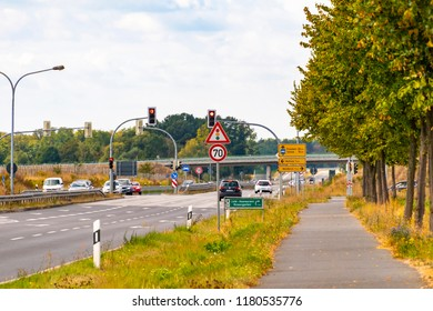 Brandenburg, Germany - September 15, 2018: Junction on a federal highway with different vehicles and a bike path on the edge of Berlin