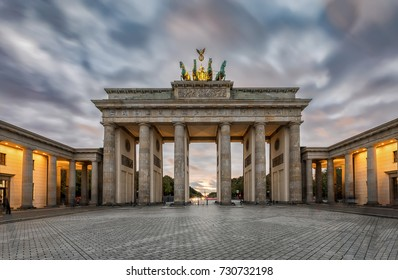 The Brandenburger Tor in Berlin, Germany, during a cloudy sunset in fall time