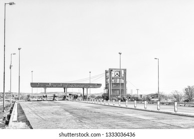 BRANDFORT, SOUTH AFRICA, AUGUST 2, 2018: The Brandfort Toll Plaza, representing a mine headgear, between Brandfort and Bloemfontein at sunset. Monochrome