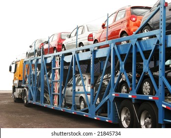 Brand-new cars on a car transport truck at Rosario city, Argentina, near the factory