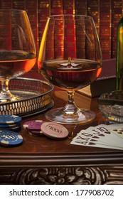 Brandy glasses (brandy snifter) in a gentleman's club. Brandy is a spirit produced by distilling wine. Often taken as an after-dinner drink.