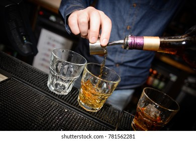 Brandy shots being poured