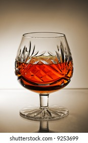 brandy snifter glass with gradient sepia background
