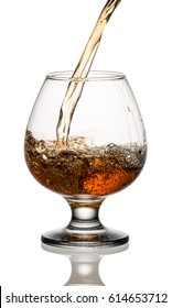 Brandy or whiskey is poured into a glass
