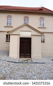 Brandys nad Labem, Czech Republic, 31.12.2018, former Jewish school, paved street in Jewish community