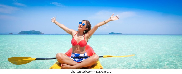 Branner of Asian woman on the kayak boat in Andaman blue sea and blue sky background location in Phuket island Thailand.