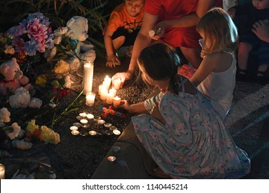 Branson, MO, USA – July 20, 2018: Mourners gather on the parking lot of Ride the Ducks for a candlelight vigil to remember the victims of the boat accident.