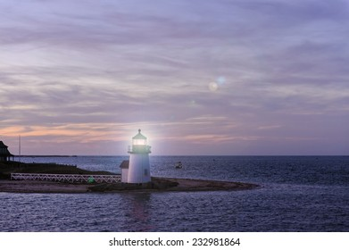 Brant Point Lighthouse during the blue hour just after sunset, located at the entrance to Nantucket Harbor, Cape Cod, Massachusetts, is the shortest light house in New England.