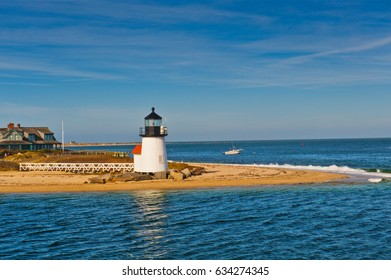 Brant Point Lighthouse at the entrance to Nantucket Harbor, Cape Cod and the islands. The 26 foot tall white wooden lighthouse is the lowest in New England.
