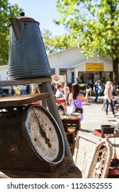 Braselton, GA / USA - April 28, 2018:  People walk and look at antiques on sale at the Braselton Antique Festival on April 28, 2018 in Braselton, GA.
