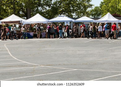 Braselton, GA / USA - April 28, 2018:  A crowd of people walk and look at antiques on sale at the Braselton Antique Festival on April 28, 2018 in Braselton, GA.