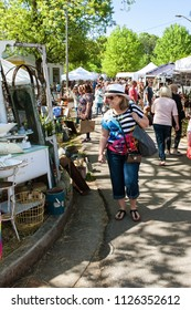 Braselton, GA / USA - April 28, 2018:  A crowd of people walks and looks at antiques on sale at the Braselton Antique Festival on April 28, 2018 in Braselton, GA.