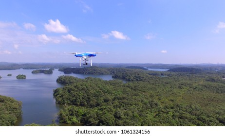 Brasil, São Bernardo do Campo - Abr 1, 2018. Flying blue quadrocopters DJI Phantom 3 over Billings Dam. Flying apparatus for video.