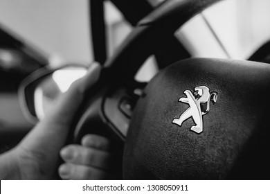 Brasil, Brasília - Distrito Federal. 08/02/2019. Logo Peugeot.  Peugeot 208 / 2014. Black and white picture.