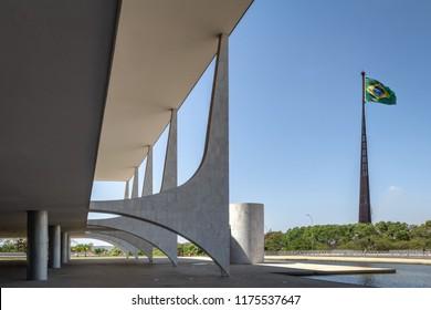Brasilia, Brasil - Aug 26, 2018: Planalto Palace and Brazilian Flag - Brasilia, Distrito Federal, Brazil