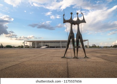 Brasilia, Brasil - Aug 26, 2018: Candangos or Warriors Sculpture at Three Powers  Plaza with Planalto Palace on background - Brasilia, Distrito Federal, Brazil