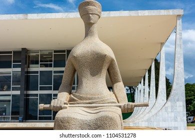 """Brasilia, Brazil - April 16, 2018: """"The Justice"""" is a sculpture located in front of the the Brazilian Supreme Court. The sculpture represents the judiciary as a woman blindfolded and sword."""