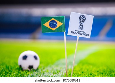 BRASILIA, BRAZIL - APRIL, 24, 2018: Brazil national flag and Official logo of Football FIFA World Cup 2018 in Russia.