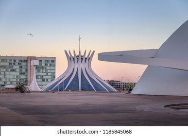 Brasilia, Brazil - Aug 24, 2018: Brasilia Cathedral and National Museum at sunset - Brasilia, Brazil