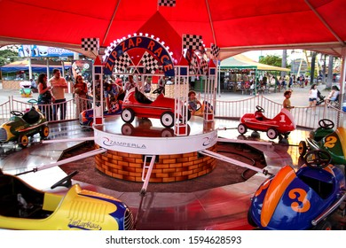 Brasilia, Brazil, December 27, 2019: Zip Zap Race, Nicolandia, Park Sarah Kubitschek. Carousel, a classic toy that delights children, a large circular spinning piece with mini strollers