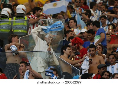 BRASILIA, BRAZIL - JULY 05, 2014: Soccer fan of Argentina dressed as Pope celebrates during the World Cup Quarter-finals game between Argentina and Belgium in the Estadio Nacional. NO USE IN BRAZIL.