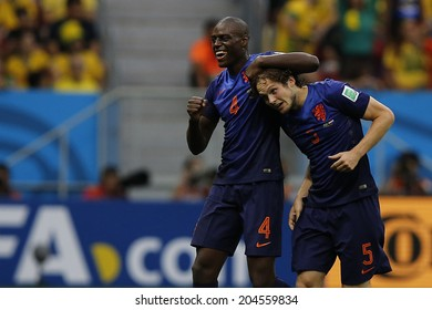 BRASILIA, BRAZIL - JULY 12, 2014: Martins and Blind of Netherlands celebrate during the World Cup Third place game between Brazil and the Netherlands in the Estadio Nacional. NO USE IN BRAZIL.