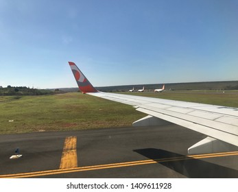Brasilia, Brazil, June 1, 2019: three GOL aircraft in ground, circulation surface for landing and takeoff, Brasília Airport, morning of cloudless blue sky.
