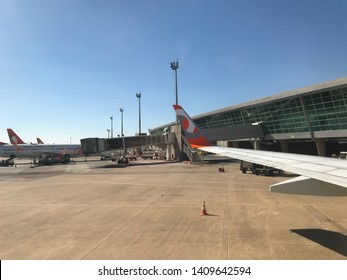 Brasilia, Brazil, June 1, 2019: The modern Presidente Juscelino Kubitschek International Airport in Brasilia, GOL aircraft in boarding and disembarking area.