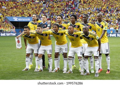 BRASILIA, BRAZIL - June 19, 2014: Colombia team posing for a photo during the FIFA 2014 World Cup. Colombia is facing Ivory Coast in the Group C at Estadio Nacional Mane Garrincha. NO USE IN BRAZIL.